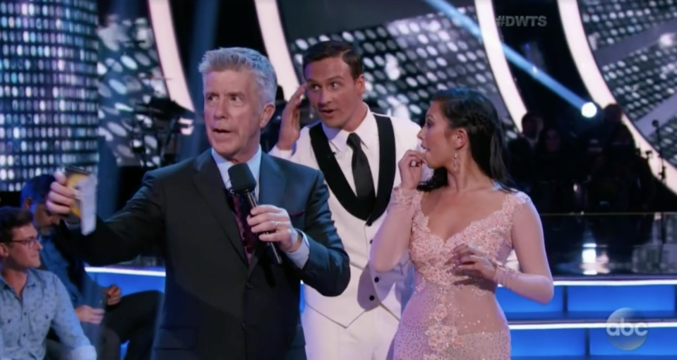 """<p>As you can see in this photo, Ryan and his partner Cheryl were extremely uncomfortable when a group of protestors wearing """"anti-Lochte"""" shirts began yelling in the studio—and a few attempted to rush at the athlete. Tom Bergeron dutifully cut to commercial break. The protesters were upset about Ryan's fake robbery allegations during the Rio Olympics.</p>"""