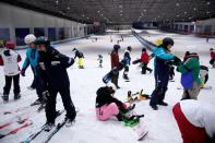 People visit indoor ski park at Qiaobo Ice and Snow World in Shaoxing