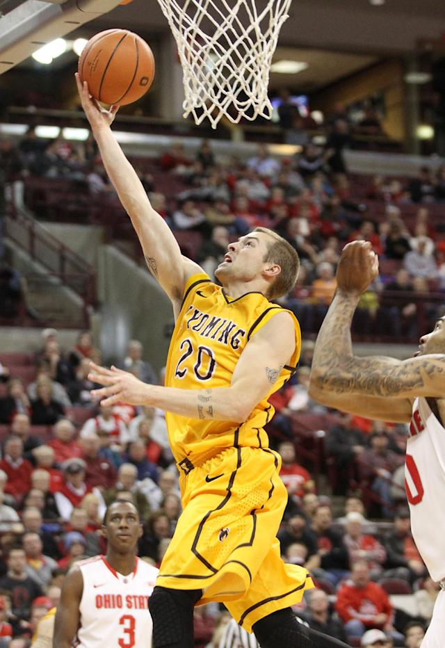 Wyoming's Nathan Sobey (20) scores against Ohio State during the second half of an NCAA college basketball game, Monday, Nov. 25, 2013, in Columbus, Ohio. (AP Photo/Mike Munden)