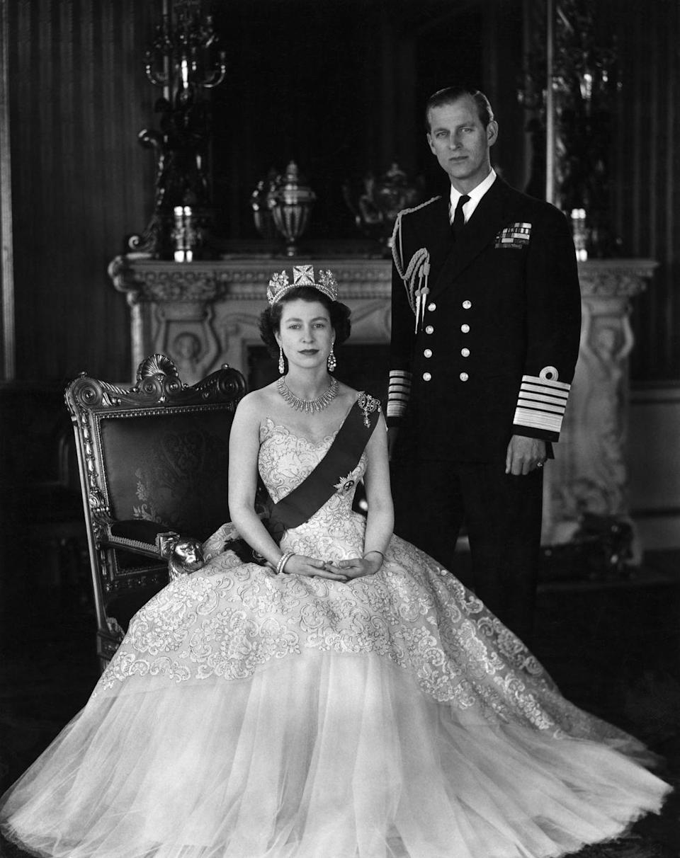 <p>Queen Elizabeth II and Prince Phillip pose for a photograph in crown and uniform.</p>