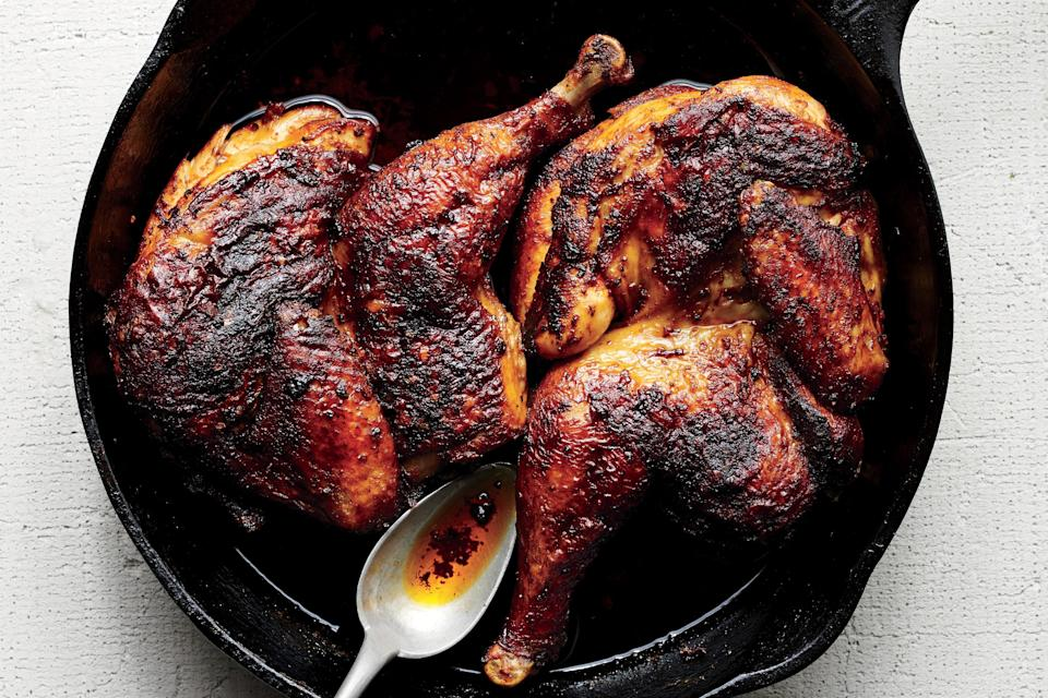 """The real magic here is in the pool of schmaltz sizzling in the pan. But your grandmother probably taught you that already. <a href=""""https://www.epicurious.com/recipes/food/views/roast-chicken-with-harissa-and-schmaltz?mbid=synd_yahoo_rss"""" rel=""""nofollow noopener"""" target=""""_blank"""" data-ylk=""""slk:See recipe."""" class=""""link rapid-noclick-resp"""">See recipe.</a>"""