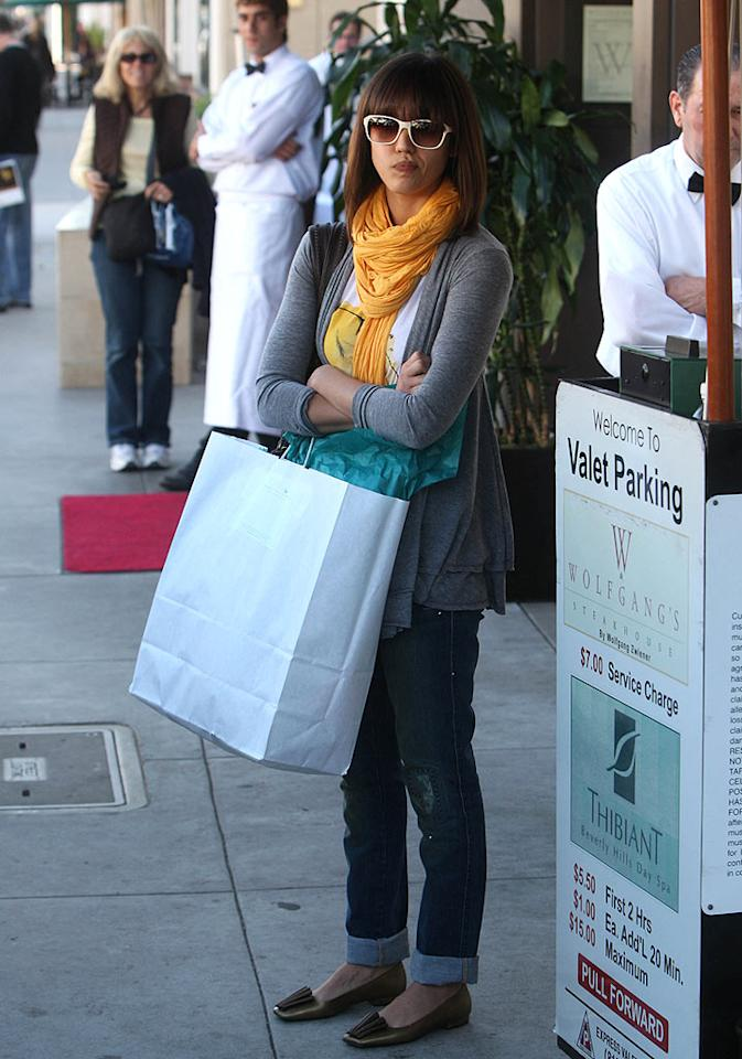 "Doesn't Jessica Alba looked just thrilled to be shopping her day away in Beverly Hills? Revolutionpix/<a href=""http://www.infdaily.com"" target=""new"">INFDaily.com</a> - January 7, 2009"