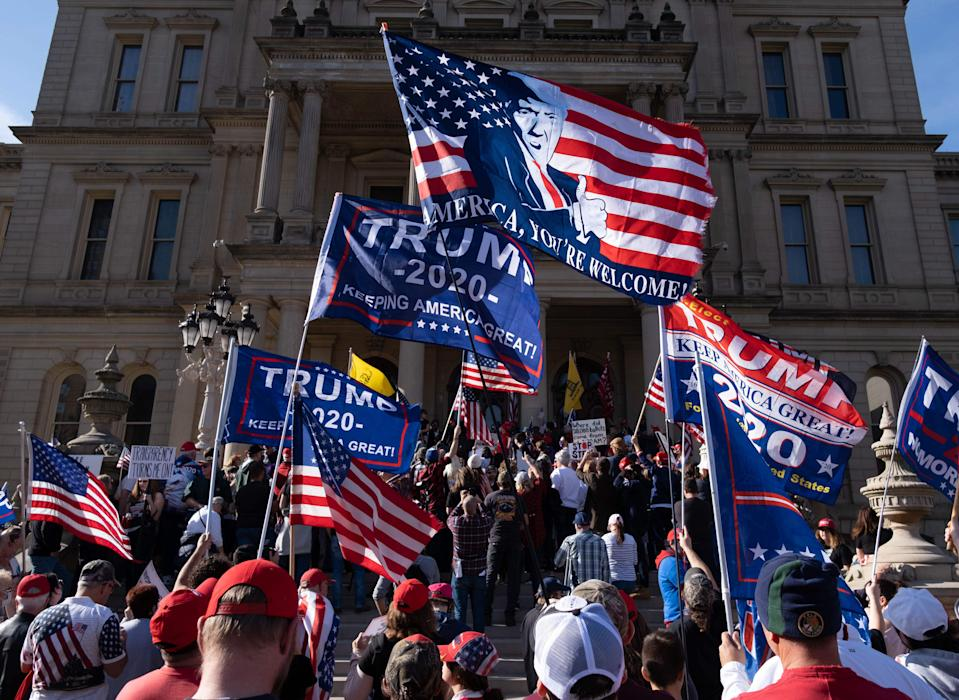 Supporters of US President Donald Trump rally at the State Capitol in Lansing, Michigan, on November 7, 2020, after Democratic Presidential nominee Joe Biden was declared the winner of the 2020 US elections.