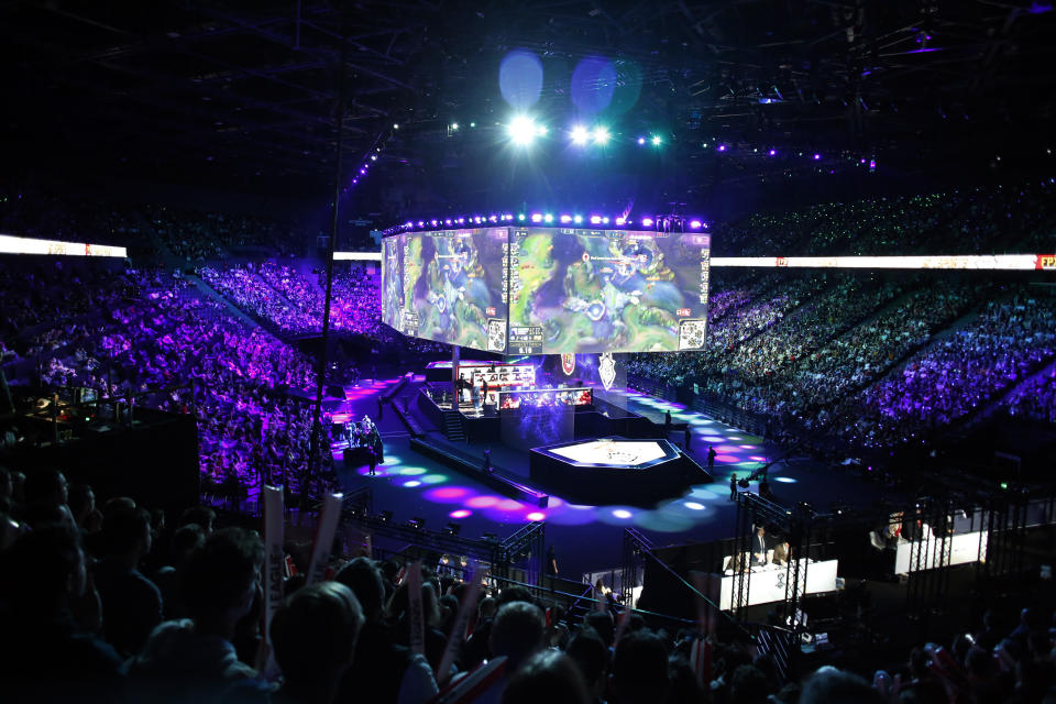A general view during the final of League of Legends tournament between Team G2 Esports and Team FunPlus Phoenix, in Paris, Sunday, Nov. 10, 2019. The biggest e-sports event of the year saw a Chinese team, FunPlus Phoenix, crowned as world champions of the video game League of Legends. Thousands of fans packed a Paris arena for the event, which marked another step forward for the growing esports business. (AP Photo/Thibault Camus)