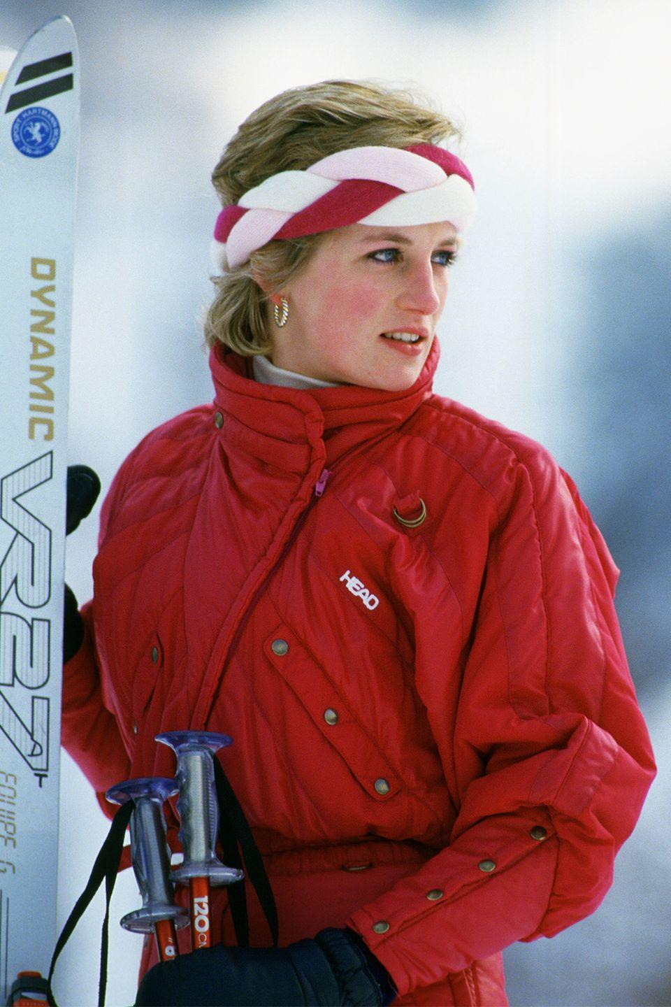 <p>For a ski trip in Switzerland, Diana kept her hair pushed back with the help of a red, pink, and white braided headband worn across her forehead.</p>