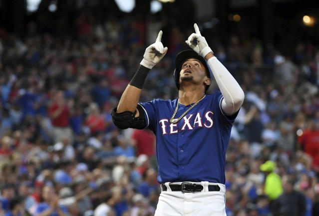 Texas Rangers' Ronald Guzman celebrates as he crosses the plate on a solo home run off New York Yankees starting pitcher Domingo German during the fourth inning of a baseball game Tuesday, May 22, 2018, in Arlington, Texas. (AP Photo/Jeffrey McWhorter)
