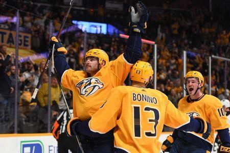 Nov 25, 2018; Nashville, TN, USA; Nashville Predators left wing Austin Watson (51) celebrates with Nashville Predators center Nick Bonino (13) and Nashville Predators center Colton Sissons (10) after a goal during the first period against the Anaheim Ducks at Bridgestone Arena. Mandatory Credit: Christopher Hanewinckel-USA TODAY Sports
