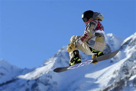 Sage Kotsenburg of the U.S. performs a jump during the men's snowboard slopestyle semi-final competition at the 2014 Sochi Olympic Games in Rosa Khutor February 8, 2014. REUTERS/Lucas Jackson