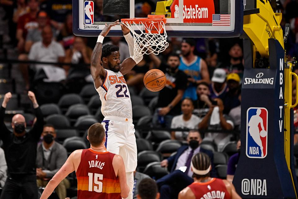 DENVER, CO - JUNE 13:  Deandre Ayton #22 of the Phoenix Suns scores on a slam dunk against the Denver Nuggets in Game Four of the Western Conference second-round playoff series at Ball Arena on June 13, 2021 in Denver, Colorado. NOTE TO USER: User expressly acknowledges and agrees that, by downloading and or using this photograph, User is consenting to the terms and conditions of the Getty Images License Agreement. (Photo by Dustin Bradford/Getty Images)