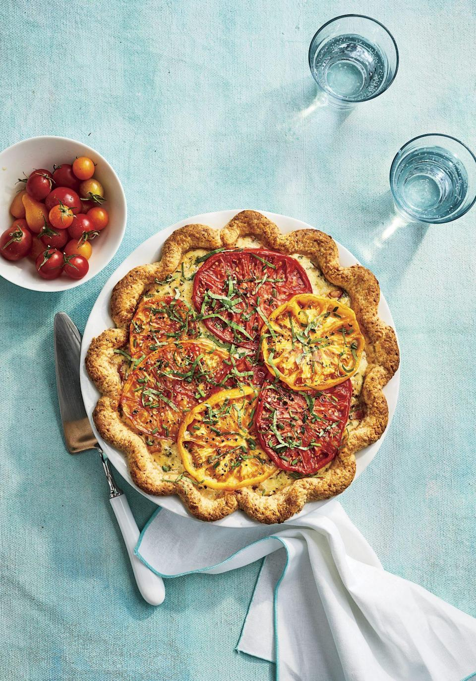 "<p><strong>Recipe: </strong><a href=""https://www.southernliving.com/recipes/heirloom-tomato-pie"" rel=""nofollow noopener"" target=""_blank"" data-ylk=""slk:Heirloom Tomato Pie"" class=""link rapid-noclick-resp""><strong>Heirloom Tomato Pie</strong></a></p> <p>If our readers aren't whipping up a BLT with their summer harvest of tomatoes, they're making tomato pie. This totally-from-scratch recipe starts with a parmesan-buttermilk crust and ends with a sprinkle of fresh herbs from the garden. Readers found ways to adapt the recipe with store-bought crusts and whatever cheese they had on hand.</p>"