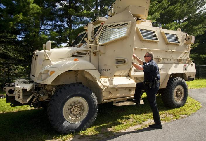 """<span class=""""caption"""">The police chief of Sanford, Maine, population 21,000, climbs into his department's mine-resistant ambush protected vehicle, one of five in the state obtained from military surplus.</span> <span class=""""attribution""""><a class=""""link rapid-noclick-resp"""" href=""""https://www.gettyimages.com/detail/news-photo/sanford-police-chief-thomas-connolly-steps-into-the-news-photo/454140118"""" rel=""""nofollow noopener"""" target=""""_blank"""" data-ylk=""""slk:Carl D. Walsh/Portland Press Herald via Getty Images"""">Carl D. Walsh/Portland Press Herald via Getty Images</a></span>"""