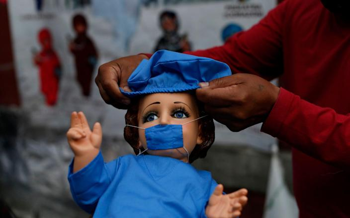 A baby Jesus figurine available for sale in Mexico City ahead of celebrations of Candlemas Day. Vendors said that some customers want a way to give thanks for family members having overcome the virus. - AP
