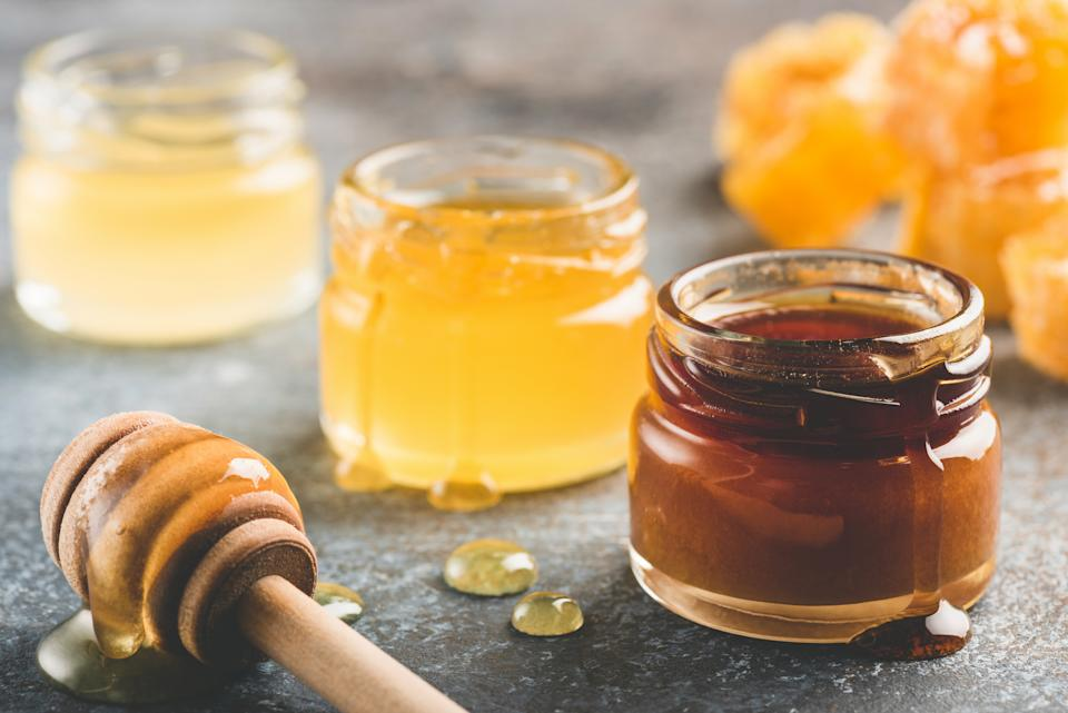 Selection of honey in small honey jars. Closeup view, toned image