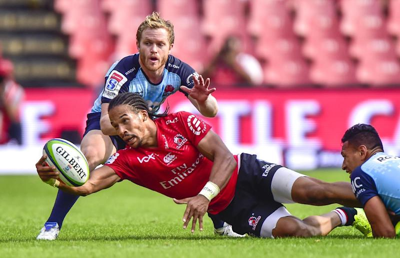 Rugby Union - Four-try Skosan helps Lions thrash 14-man Reds