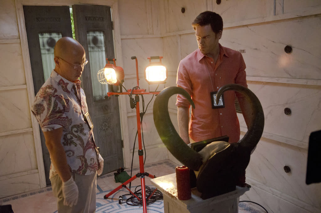 "C.S. Lee as Vince Masuka and Michael C. Hall as Dexter Morgan in the ""Dexter"" episode, ""Run."""