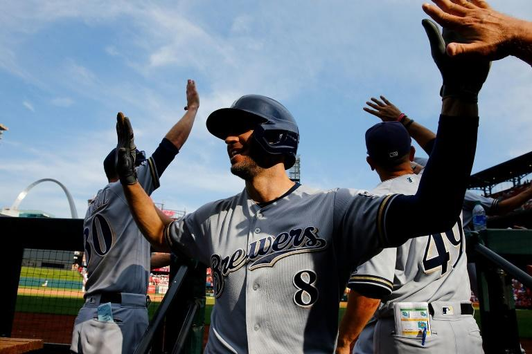 Ryan Braun of the Milwaukee Brewers celebrates after hitting a grand slam against the St. Louis Cardinals in the ninth inning at Busch Stadium