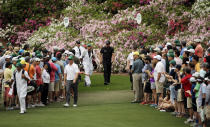 Phil Mickelson, right, and Charley Hoffman walk down the sixth fairway during the fourth round of the Masters golf tournament Sunday, April 12, 2015, in Augusta, Ga. (AP Photo/Matt Slocum)