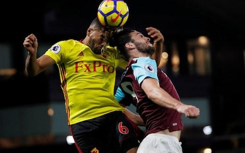 Watford's Adrian Mariappa in action with West Ham United's Andy Carroll - Credit: REUTERS