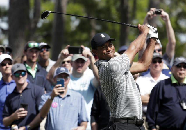 Tiger Woods hits from the seventh tee during a practice round at The Players Championship golf tournament, Wednesday, March 13, 2019, in Ponte Vedra Beach, Fla. (AP Photo/Lynne Sladky)