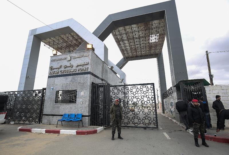 Palestinian security forces loyal to Hamas stand guard in the southern Gaza Strip at the Rafah border crossing with Egypt on January 8, 2019