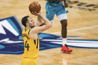 Utah Jazz forward Bojan Bogdanovic (44) shoots against the Charlotte Hornets during the second half of an NBA basketball game in Charlotte, N.C., Friday, Feb. 5, 2021. (AP Photo/Jacob Kupferman)