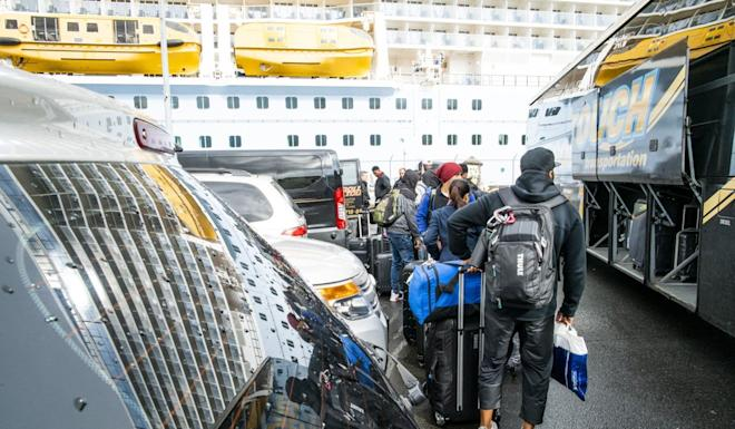 Passengers exit the port in Bayonne, New Jersey, on Friday after disembarking the Royal Caribbean cruise ship Anthem of the Seas. Twenty-seven passengers were screened for the coronavirus, four of whom were taken to a nearby hospital for further tests. Photo: Getty Images via AFP