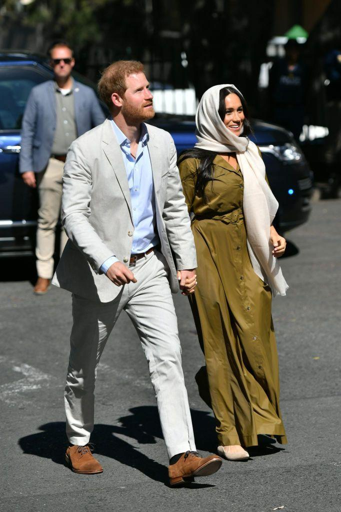 """<p>Harry and Meghan <a href=""""https://www.townandcountrymag.com/style/fashion-trends/a29205156/meghan-markle-headscarf-olive-dress-bo-kaap-heritage-day-photos/"""" rel=""""nofollow noopener"""" target=""""_blank"""" data-ylk=""""slk:also visited Auwal Mosque"""" class=""""link rapid-noclick-resp"""">also visited Auwal Mosque</a>, the oldest Mosque in South Africa, on day two of their tour. The Duchess wore a green dress with a traditional headscarf and nude flats for the outing. </p>"""