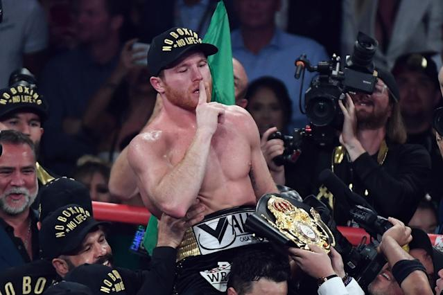 Canelo Alvarez celebrates after his majority decision win over Gennady Golovkin during their WBA-WBC middleweight title fight at T-Mobile Arena on Saturday in Las Vegas. (Getty Images)