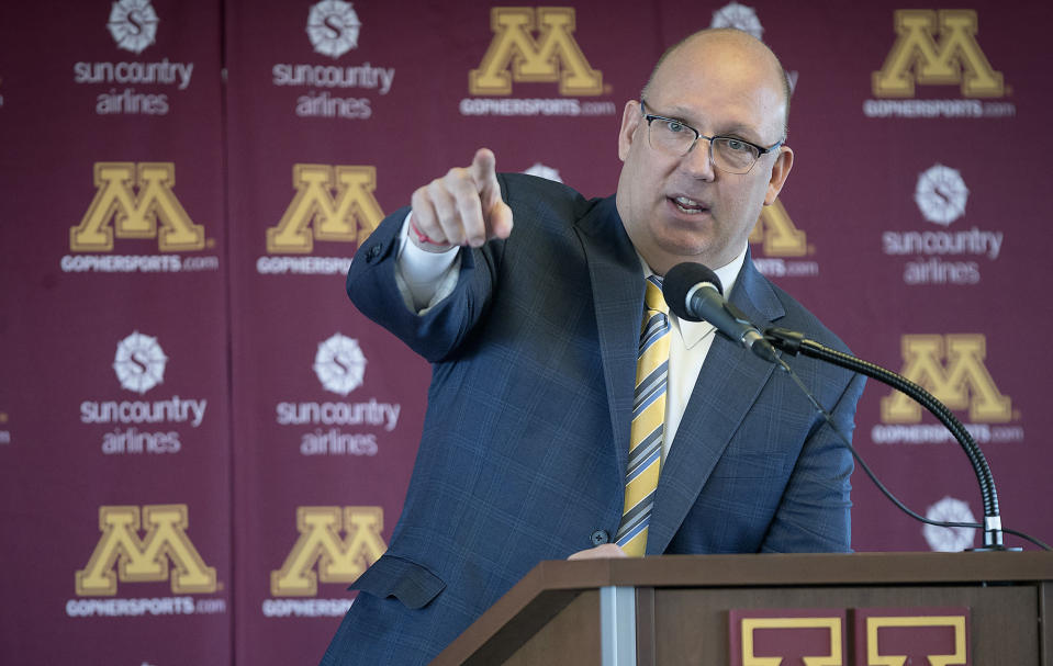 FILE - Bob Motzko, Minnesota men's hockey coach, gestures during an introductory news conference in Minneapolis, in this Thursday, March 29, 2018, file photo. The NCAA men's hockey tournament bracket this year would have made Herb Brooks proud. For the first time, all five Division I programs from Minnesota made the 16-team field. (Elizabeth Flores/Star Tribune via AP, File)
