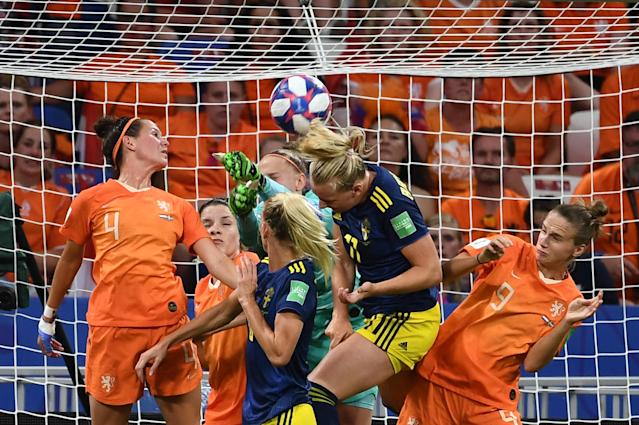 Netherlands' goalkeeper Sari van Veenendaal (C) boxes the ball in front of Sweden's forward Stina Blackstenius (2ndR) during the France 2019 Women's World Cup semi-final football match between the Netherlands and Sweden, on July 3, 2019, at the Lyon Stadium in Decines-Charpieu, central-eastern France. (Photo by Franck Fife/AFP/Getty Images)