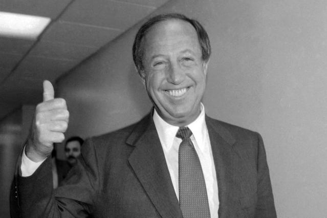 FILE - In this June 22, 1982, file photo, National Football League commissioner Pete Rozelle gives the thumbs-up sign at labor hearings in New York. (AP Photo/Dave Pickoff, File)