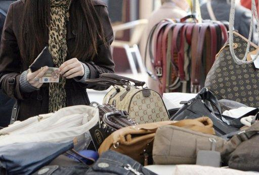Shoppers buy bags in Ventimiglia, northern Italy, in 2010