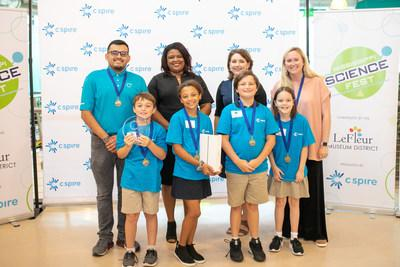 Back row (left to right) C Spire mentor Martin Guzman, C Spire CTO Carla Lewis, Mississippi Children's Museum President and CEO Susan Garrard and teacher Kelly Edwards are all smiles as they celebrate with the winning Madison Ridgeland Academy team in the second annual C Spire C3 Jr. 2019 coding challenge. Front row (left to right): 4th grade students Johhny Fondren, Kennedy High, Sharps Vance and Memary Yates (team members)