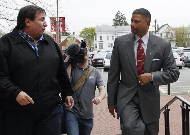 Former Rutgers basketball stand out and Los Angles Lakers assistant coach Eddie Jordan, right, is greeted by a supporter as he arrives at Rutgers Tuesday, April 23, 2013, in New Brunswick, N.J., to be named head basketball coach at Rutgers. (AP Photo/Mel Evans)