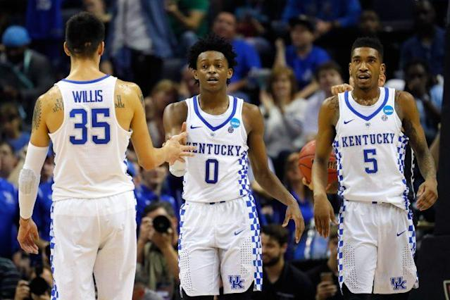 De'Aaron Fox (0) celebrates with Derek Willis (35) and Malik Monk (5) during Kentucky's win over UCLA on Friday. (Getty)