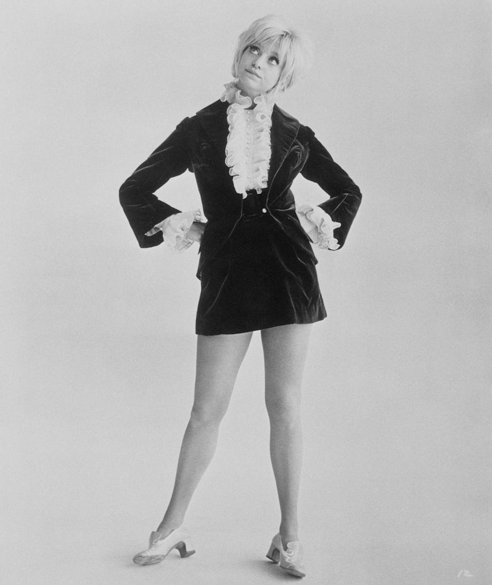 <p>Goldie Hawn gave these slip-ons a Victorian feel with her ruffled shirt and velvet dress. </p>