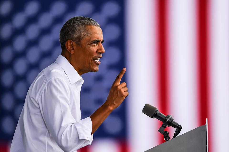 Former US President Barack Obama speaks at a Biden-Harris drive-in rally in Miami, Florida on October 24, 2020. (Photo by CHANDAN KHANNA / AFP) (Photo by CHANDAN KHANNA/AFP via Getty Images)