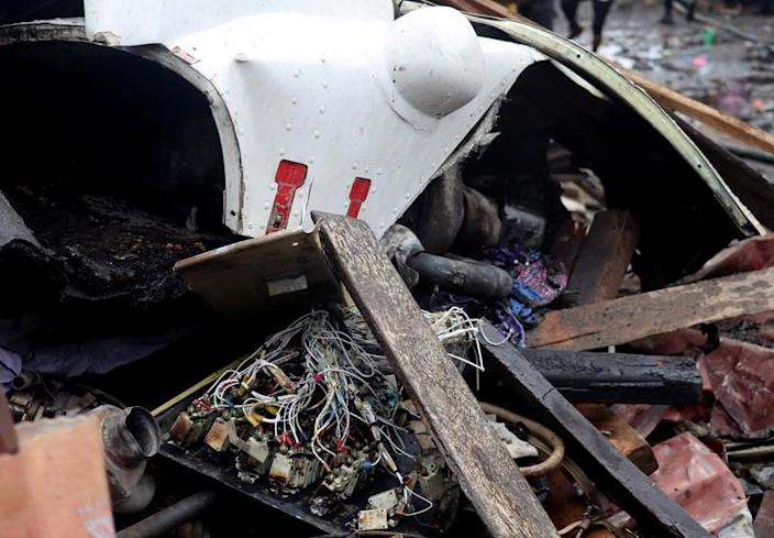 The wreckage of a Dornier 228-200 plane operated by local company Busy Bee is seen at a crash site in Goma