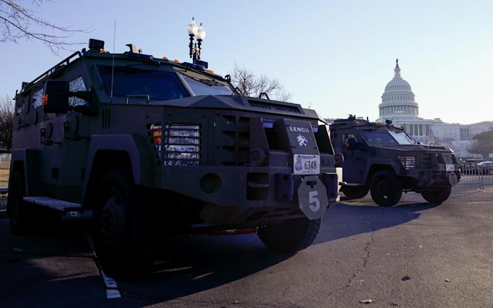 Armoured law enforcement vehicles are parked outside the U.S. Capitol - Erin Scott/Reuters