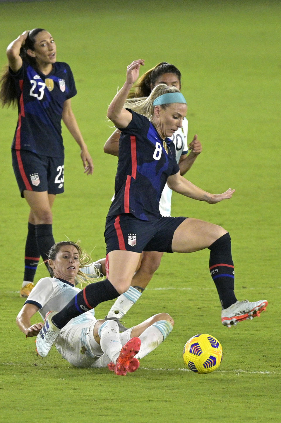 United States midfielder Julie Ertz (8) and Argentina midfielder Clarisa Huber, below, compete for a ball during the first half of a SheBelieves Cup women's soccer match, Wednesday, Feb. 24, 2021, in Orlando, Fla. (AP Photo/Phelan M. Ebenhack)