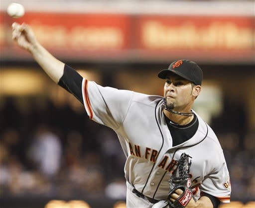San Francisco Giants starting pitcher Ryan Vogelsong throws a pitch while facing the San Diego Padres during the first inning of a baseball game Friday, Sept. 28, 2012 in San Diego. (AP Photo/Lenny Ignelzi)