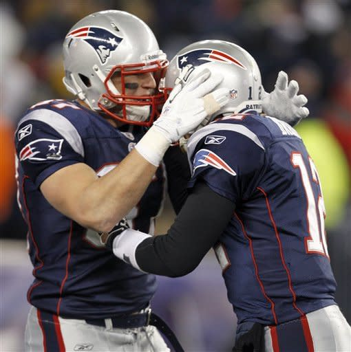 New England Patriots tight end Rob Gronkowski, left, celebrates his 19-yard touchdown reception with quarterback Tom Brady during the first half of an NFL divisional playoff football game Saturday, Jan. 14, 2012, in Foxborough, Mass. (AP Photo/Elise Amendola)
