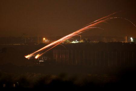 FILE PHOTO: Israeli soldiers shoot tear gas from the Israeli side of the border with Gaza during night protests held by Palestinians in Gaza close to the border fence, as seen from southern Israel March 27, 2019. REUTERS/Amir Cohen/File Photo