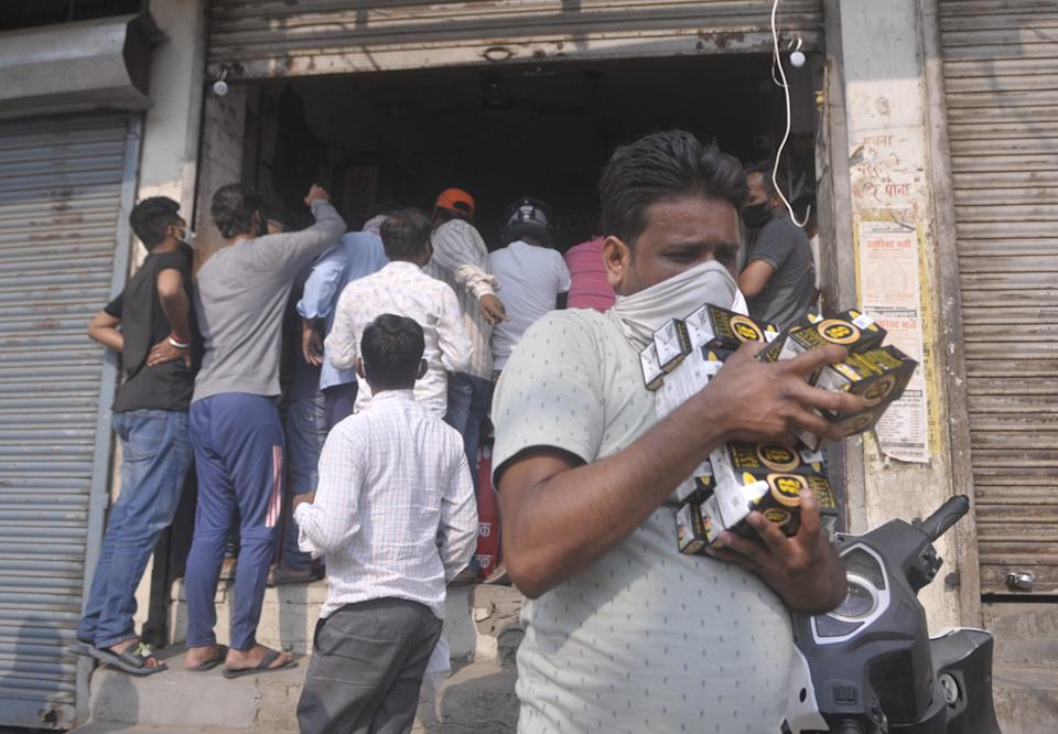 BARABANKI, INDIA - MAY 12: A rush of people looking to purchase alcohol at an overcrowded liquor vend  on May 12, 2021 in Barabanki, India.  (Photo by Deepak Gupta/Hindustan Times via Getty Images)