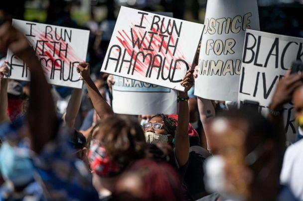 PHOTO: Demonstrators protest the shooting death of Ahmaud Arbery at the Glynn County Courthouse, May 8, 2020, in Brunswick, Ga. Gregory McMichael and Travis McMichael were arrested the previous night and charged with murder. (Sean Rayford/Getty Images)