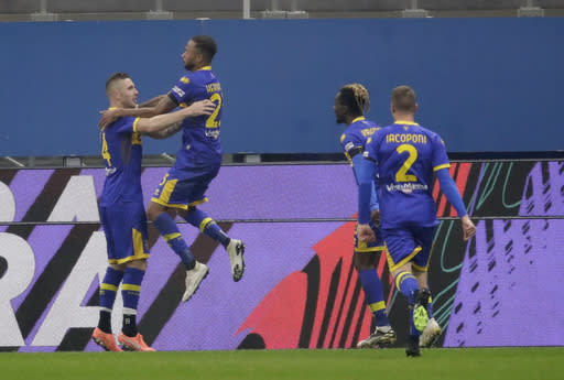 Parma's Jasmin Kurtic, left, celebrates with his teammate Parma's Yordan Osorio after scoring his side's second goal during a Serie A soccer match between AC Milan and Parma, at the San Siro stadium in Milan, Italy, Sunday, Dec. 13, 2020. (AP Photo/Luca Bruno)