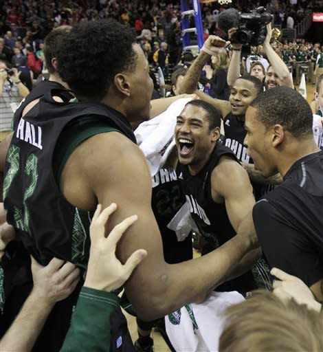 Ohio teammates celebrate after defeating Akron 64-63 in an NCAA college basketball championship game in the Mid-American Conference men's tournament Saturday, March 10, 2012, in Cleveland. (AP Photo/Tony Dejak)