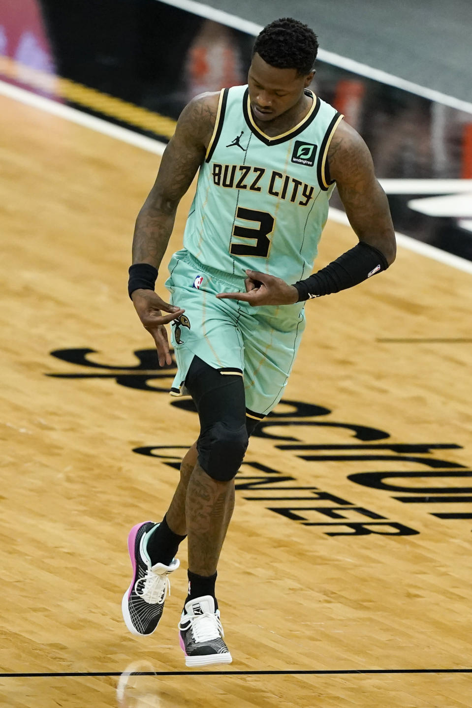 Charlotte Hornets guard Terry Rozier celebrates after scoring against the Denver Nuggets during the first half of an NBA basketball game on Tuesday, May 11, 2021, in Charlotte, N.C. (AP Photo/Chris Carlson)