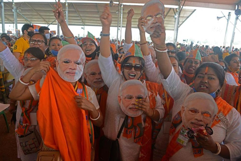 BJP supporters attend a rally on the outskirts of Siliguri on 10 April.