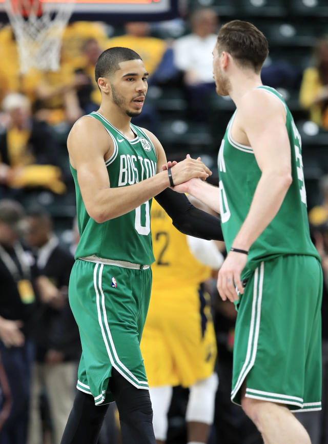 INDIANAPOLIS, INDIANA - APRIL 19: Jayson Tatum #0 and Gordon Hayward #20 of the Boston Celtics celebrate after the 104-96 win against the Indiana Pacers in game three of the first round of the 2019 NBA Playoffs at Bankers Life Fieldhouse on April 19, 2019 in Indianapolis, Indiana. (Photo by Andy Lyons/Getty Images)